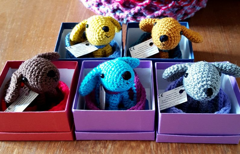 amigurumi dogs in their gift boxes